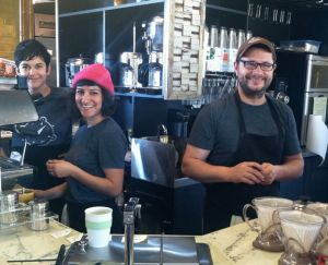 Leon, Areli, and a staffer behind the bar of their new shop.