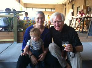 Owners Frank and Mo Ferrell (and grandchild) at their patio opening party.